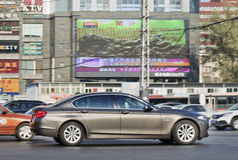 BMW 7 series in busy city center, Beijing, China Stock Images