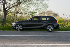 BMW series 3 car. Driving on a countryside road Royalty Free Stock Images