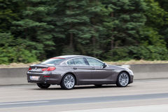 BMW 6 Series Coupe on the highway Royalty Free Stock Images