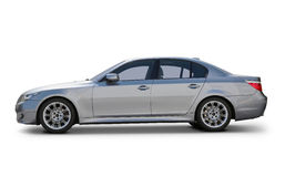 BMW 5 Series Luxury car. BMW 5 Series Sedan Luxury car side view - includes separate clipping paths for car body, windows and realistic shadows stock photography