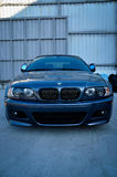 BMW sport car. Front view of the sport BMW. Close-up BMW logo. Chrome metal Stock Photos