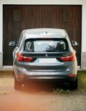 BMW SUV in front of garage door royalty free stock photo