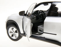 BMW SUV side view. Close-up of grey BMW X5 SUV car side view on white Stock Image
