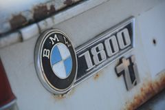 BMW 1800 ti badge. BMW logo on back of rusted white car royalty free stock image