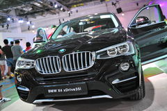BMW X4 compact luxury crossover SUV vehicle on display at BMW World 2014 Royalty Free Stock Image