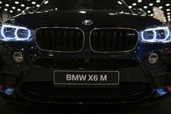 BMW X6M 2017. Headlight of a modern sport car. Front view of luxury sport car. Car exterior details. Royalty Free Stock Photography