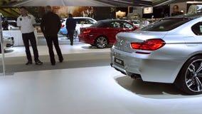 BMW X6 M SUV and 6 Series Gran Coupe sedan stock video footage