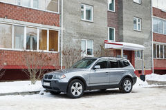 BMW X3 parked in winter near the house. Stock Image