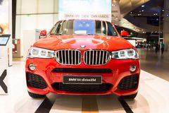 BMW X4 xDrive 35d in red presented at BMW World showroom in Munich, Germany Stock Photography