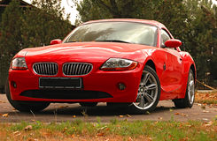 BMW Z4 concept sports car. Red  BMW sports car in autumn park Stock Image