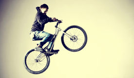 BMX. Jump on BMX bicycle, indoor royalty free stock images