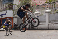 BMX acrobat. BMX bicycles are quite popular in Ho Chi Minh / Saigon city among their youth. Young Tanh Ga is one of the best BMX drivers in Ho Chi Minh / Saigon Stock Photo