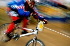 BMX actions 01. A BMX biker rides down a dirt hill fast Stock Photography