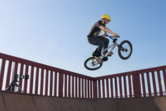 Bmx Air. A teenage Bmx rider, goes big for the camera stock image