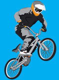 BMX bicycle. And boy on the blue background Stock Image