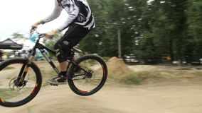 BMX bicycle challenge, rider struggling to finish race first. Stock footage stock footage