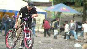BMX bicycle rider preparing bike for downhill ride, going down. Stock footage stock footage