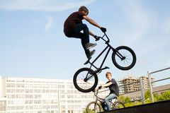 BMX bicycler over ramp. Young  boy is jumping with his BMX Bike at the skate park Royalty Free Stock Images