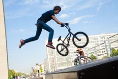 BMX bicycler over ramp. Young  boy is jumping with his BMX Bike at the skate park Stock Image