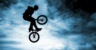 Bmx bike over blue sky background. Royalty Free Stock Image
