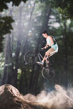 Bmx bike rider in the forest Royalty Free Stock Photography