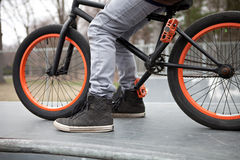BMX Bike Rider. Parked atop a ramp at the skate park Royalty Free Stock Photography
