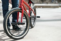 BMX Bike Rider. Parked at the skate park. Shallow depth of field Royalty Free Stock Images