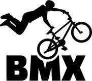 BMX bike rider stunt. Silhouette Stock Photo