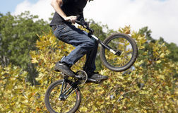 BMX Biker. Airborne BMX biker Royalty Free Stock Photos