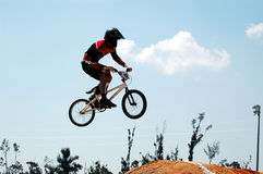 BMX Biker. A BMX Biker airborne during a jump royalty free stock photos