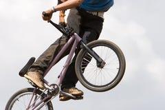 BMX biker Airborne Stock Images