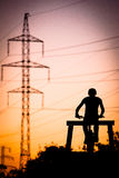 Bmx biker at sunset. Jump bmx biker at sunset, in background electric pylon royalty free stock photos