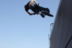 BMX Biker On A Wave. BMX biker airborne on a wave/ramp Stock Images