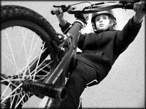 BMX Boy. Boy looking down from BMX cycle Royalty Free Stock Photos