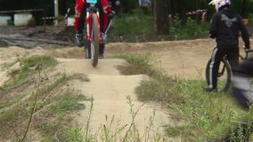 BMX challenge contestants test track before bicycle race starts. Stock footage stock footage