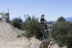 BMX cyclist jumping Royalty Free Stock Photos