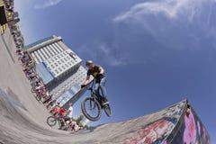 BMX cyclist performs a stunt jump Stock Photos