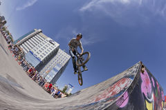 BMX cyclist performs a stunt jump Royalty Free Stock Image