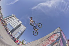 BMX cyclist performs a stunt jump Stock Photography