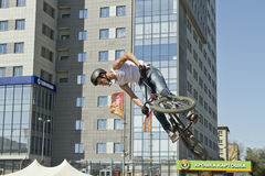 BMX cyclist performs a stunt jump Royalty Free Stock Photo