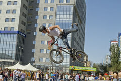 BMX cyclist performs a stunt jump Royalty Free Stock Photos