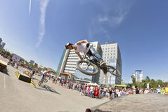 BMX cyclist performs a stunt jump Stock Images