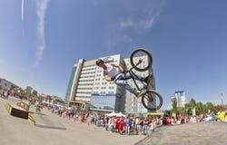 BMX cyclist performs a stunt jump Royalty Free Stock Photos