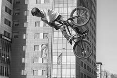 BMX cyclist performs a stunt jump Stock Photography