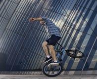 Bmx freestyle. A man on bmx doing tricks. Stock Photos