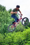 BMX freestyle teenage biker jumping high stock image