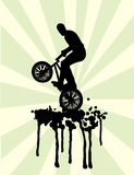 Bmx jump on splash in black and green Stock Images