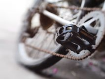 BMX pedal. Closeup parts of hard used bicycle motocross , dirty pedal Royalty Free Stock Photography