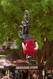 BMX Pro Gets Upside Down Performing Trick In Competition Royalty Free Stock Photography