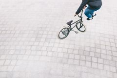 BMX racer makes complex tricks. Top view. minimalist photo of a cyclist who does tricks on a BMX bike. BMX racer makes complex tricks. Top view. The minimalist royalty free stock images